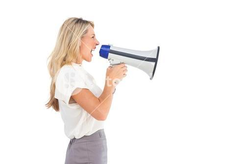 Side view of a businesswoman with megaphone