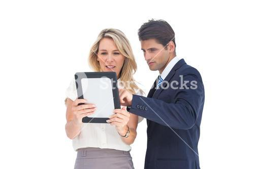 Business people looking at a pc tablet