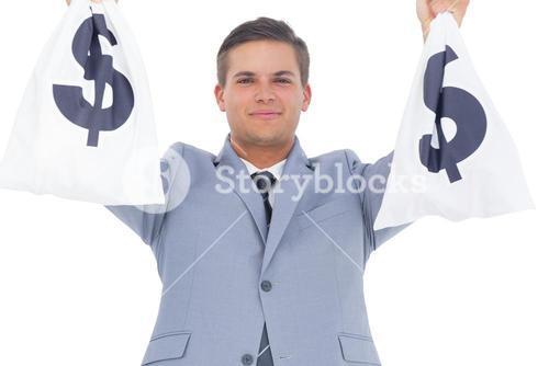 Businessman raising hands with money bags