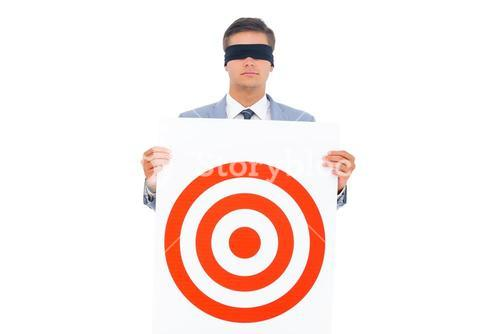 Man with blindfolded and a target