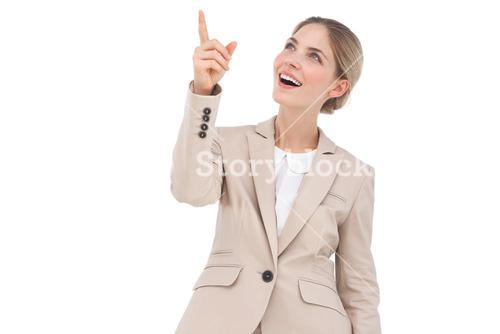 Smiling businesswoman pointing something