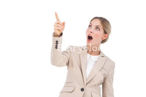 Surprised businesswoman pointing something