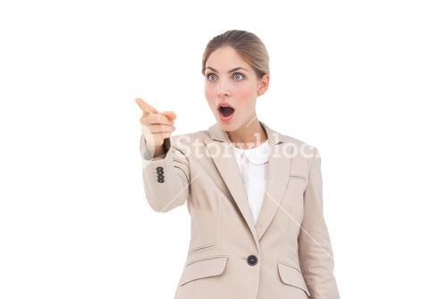 Astonished businesswoman pointing something