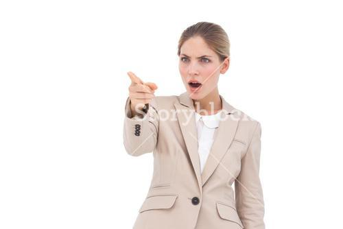 Confused businesswoman pointing something