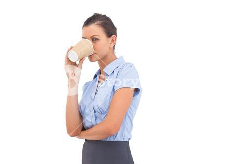 Businesswoman drinking cup of coffee