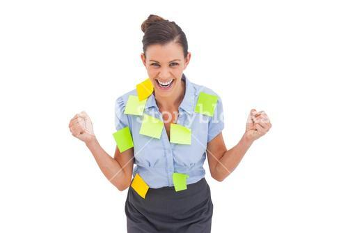 Businesswoman triumphing with adhesive notes