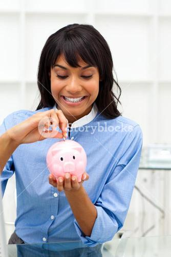 Enthusiastic businesswoman saving money in a piggybank