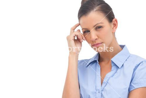 Thinking businesswoman with hand on head