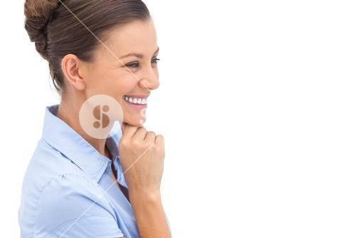 Laughing businesswoman with hand on chin