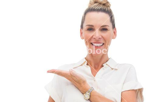 Businesswoman presenting something with palm