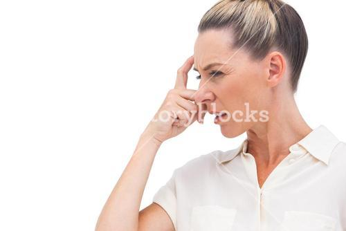 Confused businesswoman with hand on forehead