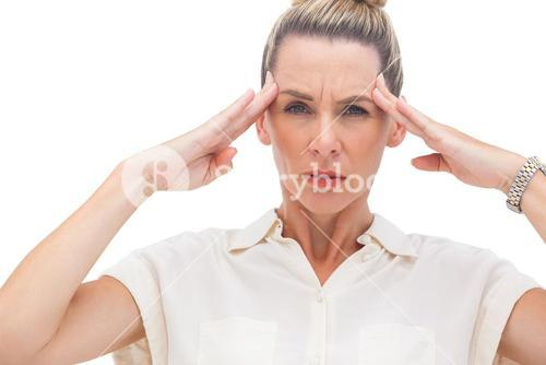 Wincing businesswoman with hand on head