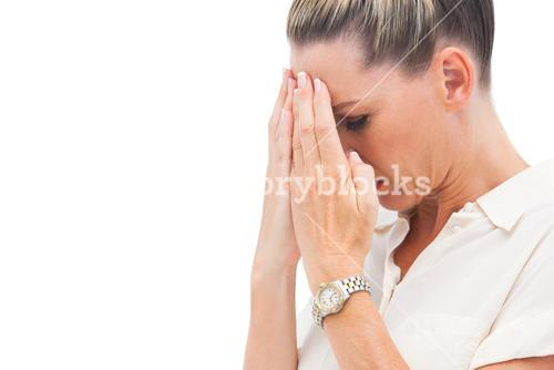 Afraid businesswoman with hands on head