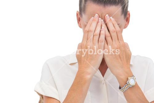 businesswoman covering her face