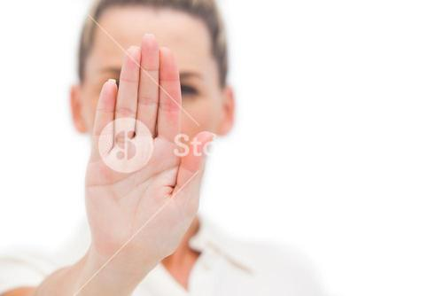 Businesswoman doing stop with palm