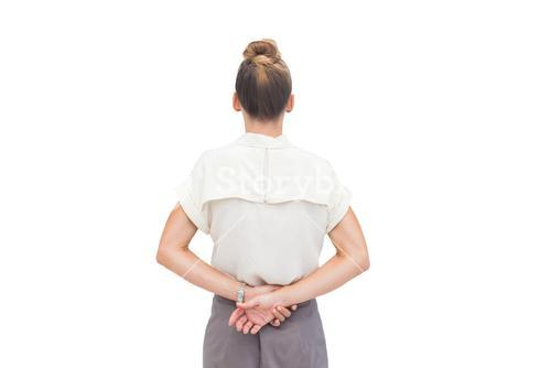 Businesswoman with hands behind her back
