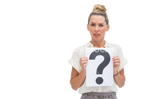 Uncertain businesswoman with question mark