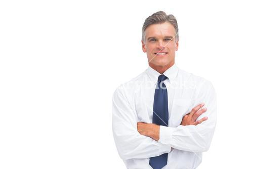 Friendly businessman with crossed arms