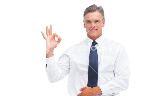 Mature businessman saying ok with hand