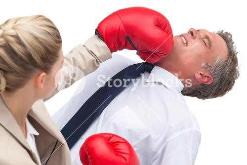 Businesswoman boxing her co worker