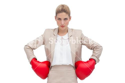 Determined businesswoman with boxing gloves