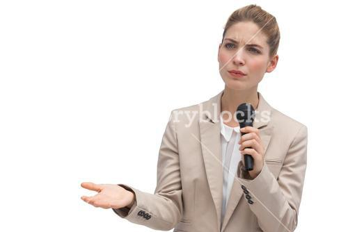 Frowning businesswoman holding microphone