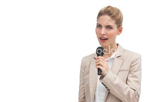 Frowning businesswoman with microphone