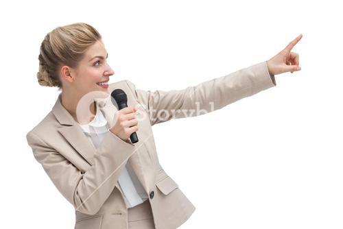 Businesswoman with microphone indicating something