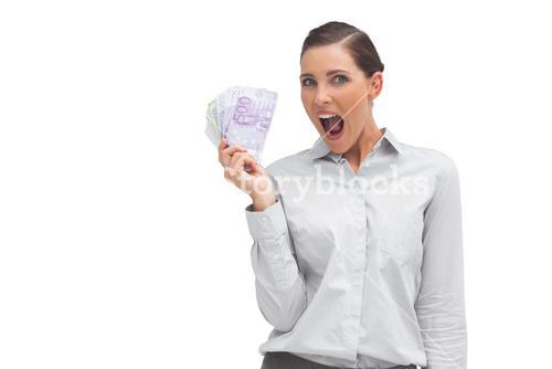 Cheerful businesswoman showing lot of money
