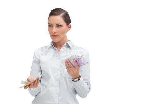Businesswoman holding wads of cash