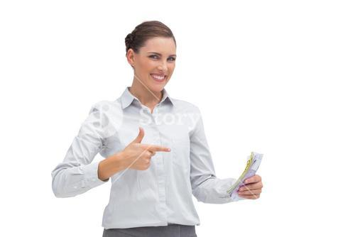 Happy businesswoman with money in her hand