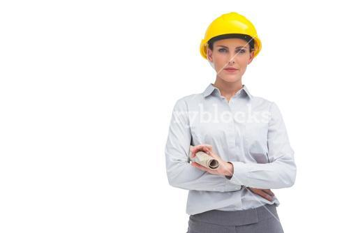 Architect woman with yellow helmet and rolled up plan