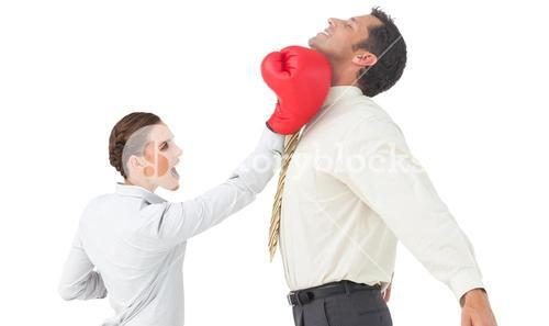 Businesswoman hitting a businessman with boxing gloves