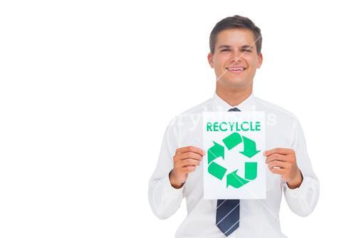 Happy businessman showing a paper with environmental awareness sign