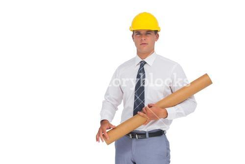 Architect holding a rolled up blueprint