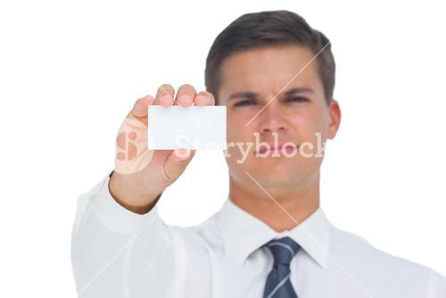 Businessman showing a white blank business card