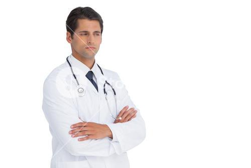 Doctor with arms crossed frowning