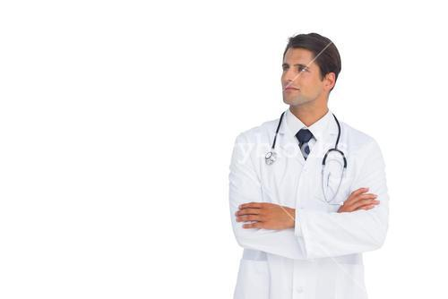 Smliing doctor with arms crossed looking up