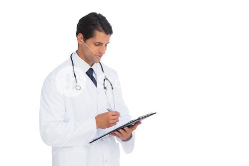 Smiling doctor holding pen and clipboard