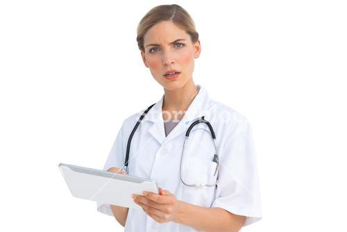 Puzzled nurse with tablet pc