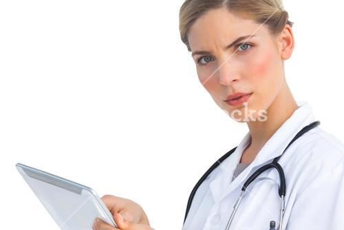 Serious nurse with tablet pc