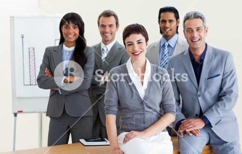 Cheerful business people around a conference table