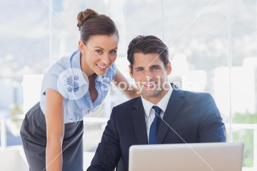 Business people smiling together