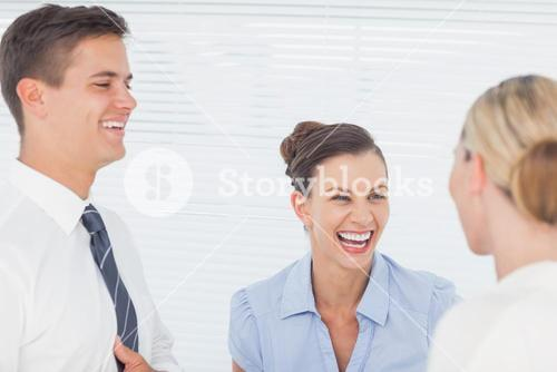 Happy business people laughing together