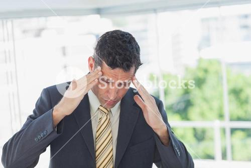 Businessman rubbing his temples