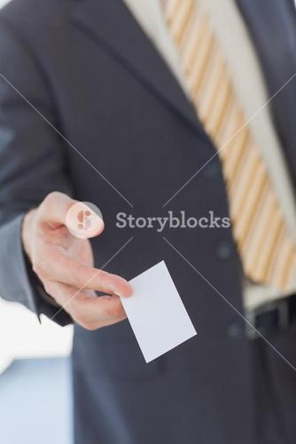 Businessman giving a white blank business card