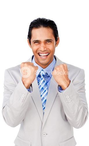 Portrait of a successful businessman punching the air
