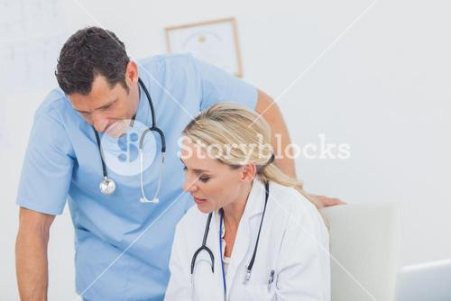 Blonde doctor working with her colleague