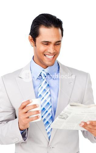 Attractive businessman driking coffee and reading a newspaper
