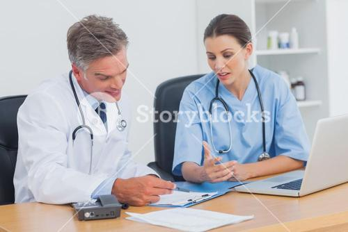 Two doctors working on an important folder
